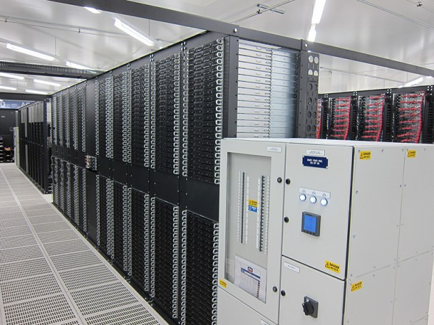 Amsterdam Data Center - A power distribution unit (PDU) and a standard row of cabinets, full of SiteGround servers.