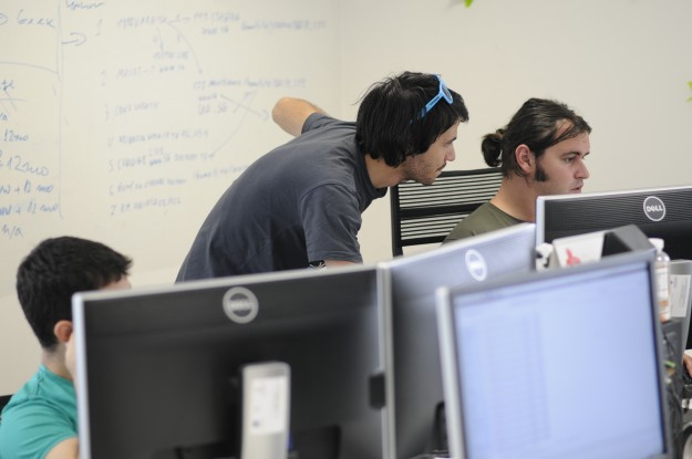 The software developers work closely with the customer service teams to implement client feature requests.